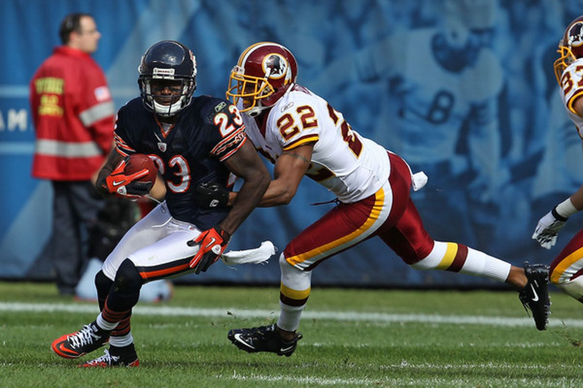 Devin Hester of the Bears avoids a tackle attempt by Carlos Rogers of the Washington Redskins at Soldier Field on October 24 2010 in Chicago Illinois. The Redskins defeated the Bears 17-14. (Photo by Jonathan Daniel/Getty Images)