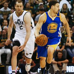 Golden State Warriors guard Klay Thompson #11 drives past Utah Jazz forward Joe Ingles #2 during game four of the Western Conference Semifinal at Vivant Smart Home Arena in Salt Lake City on Monday, May 8, 2017.