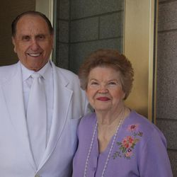 President Thomas S. Monson and his wife, Sister Frances Monson, pause outside the Oquirrh Mountain Utah Temple after the first dedicatory session Aug. 21, which was his 82nd birthday., {td0w}, Aug.21, 2009 in South Jordan, Utah. Gerry Avant, Deseret News