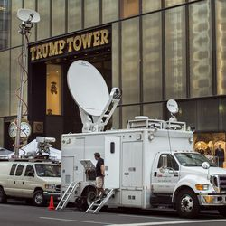 """Members of the media wait outside Trump Tower on New York's Fifth Avenue, Thursday, July 14, 2016. Donald Trump abruptly postponed plans to announce his vice presidential pick Thursday night following a day of rampant speculation, citing the """"horrible attack"""" in Nice, France, that left scores dead. Trump had planned to hold his first event with his yet-to-be-announced running mate Friday morning in New York."""
