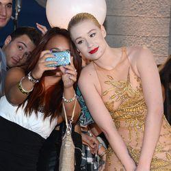 Iggy Azalea poses with a fan.