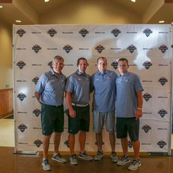 Mark Brunell, Max Hall, Brandon Doman and Dustin Smith pose for a photo at the Quarterback Elite camp at Lone Peak Park in Sandy on Friday, July 1, 2016.