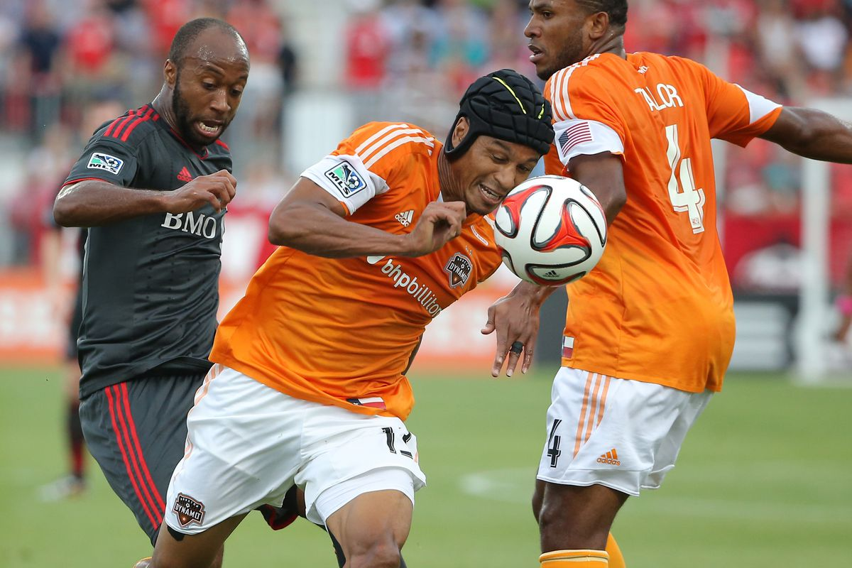 Ricardo Clark, sporting concussion protection, lends his expertise against Toronto FC