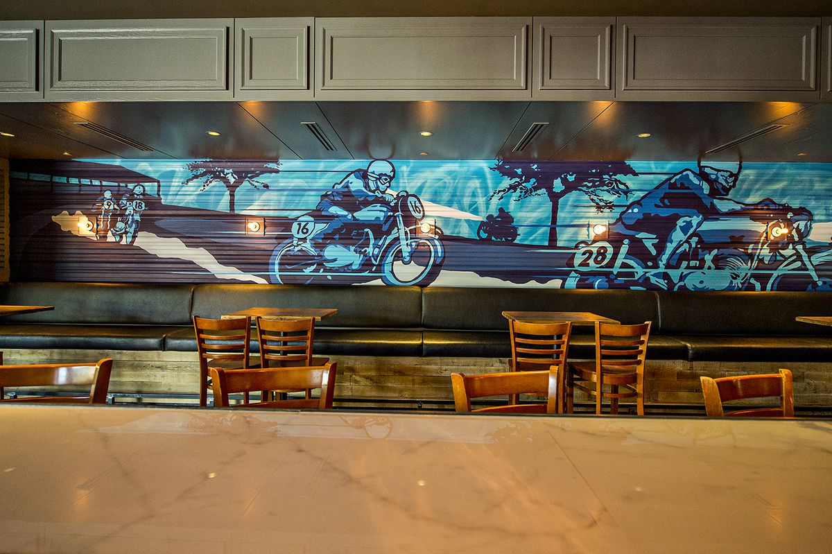 Looking out from behind the bar offers a view of a mural inspired by street art.