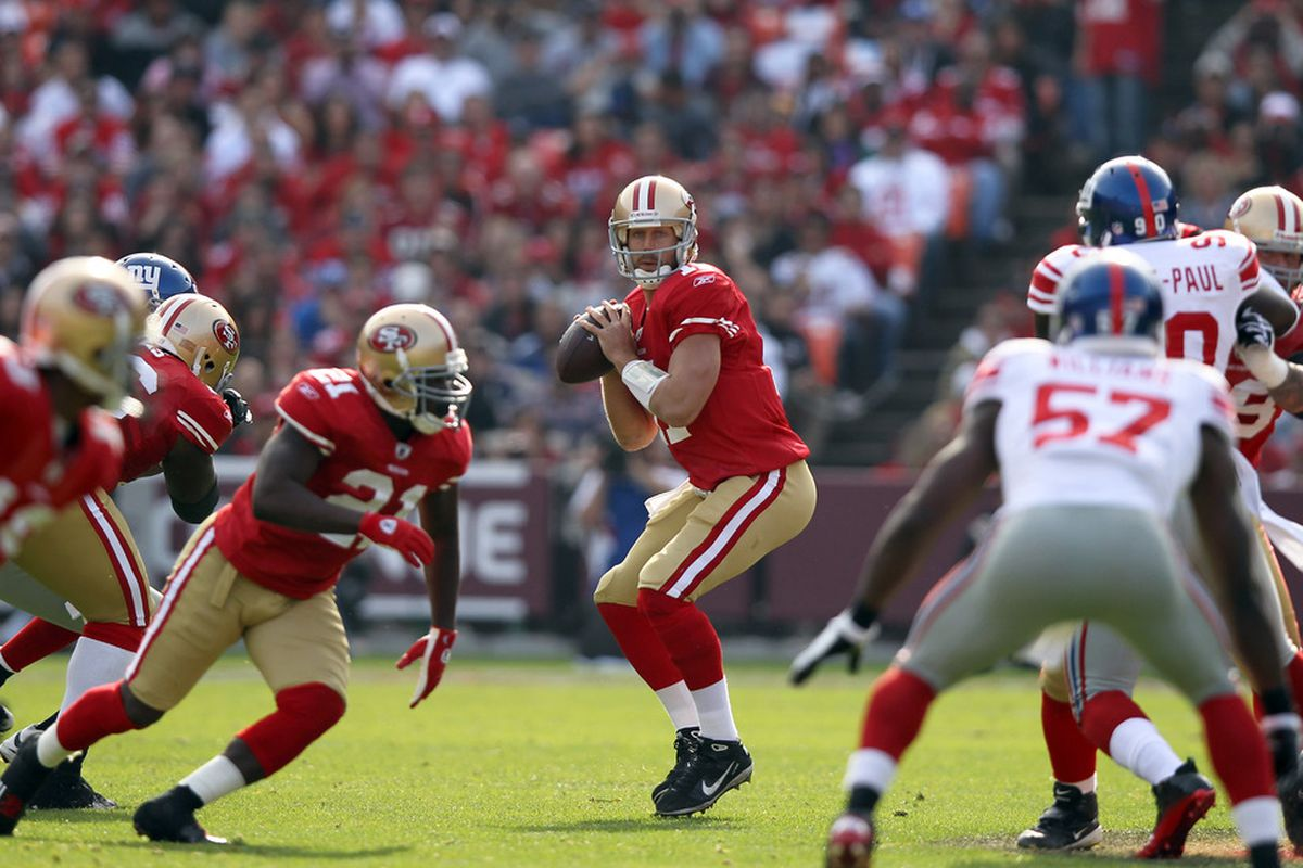 SAN FRANCISCO, CA - NOVEMBER 13:  Alex Smith #11 of the San Francisco 49ers drops back to pass the ball against the New York Giants at Candlestick Park on November 13, 2011 in San Francisco, California.  (Photo by Ezra Shaw/Getty Images)