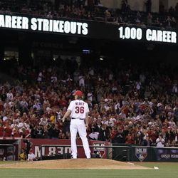 Los Angeles Angels starting pitcher Jered Weaver stand on the mound after his 1,000th career strikeout, during the sixth inning of a baseball game against the Oakland Athletics in Anaheim, Calif., Monday, April 16, 2012.
