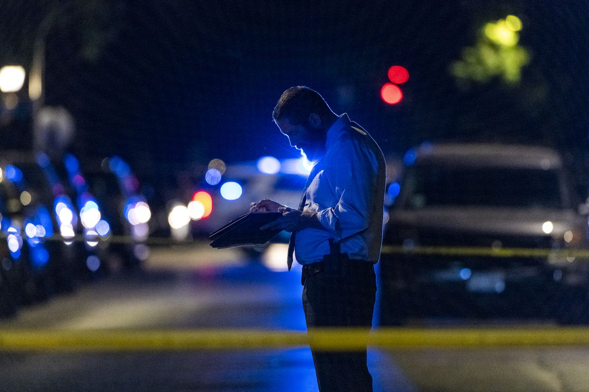 Chicago police work the scene where a 42-year-old woman was critically wounded in a shooting in the 2900 block of West 25th St, in the Little Village neighborhood, Thursday, June 17, 2021.   Tyler LaRiviere/Sun-Times