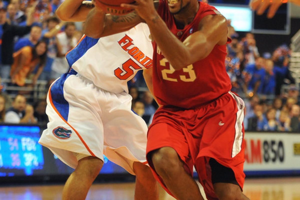 GAINESVILLE FL - NOVEMBER 16: Guard David Lighty #23 of the Ohio State Buckeyes drives for a basket against the Florida Gators November 16 2010 at the Stephen C. O'Connell Center in Gainesville Florida.  (Photo by Al Messerschmidt/Getty Images)