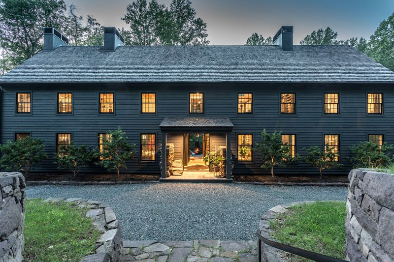To Create A Farmhouse Industrial Feel Rustic Design Elements Like Exposed Beams Beadboard Walls And Masonry Chimneys Were Joined With Sleek Modern