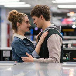 """Baby (Ansel Elgort) helps Debora (Lily James) do her laundry as they dance around each other and kiss in """"Baby Driver."""""""