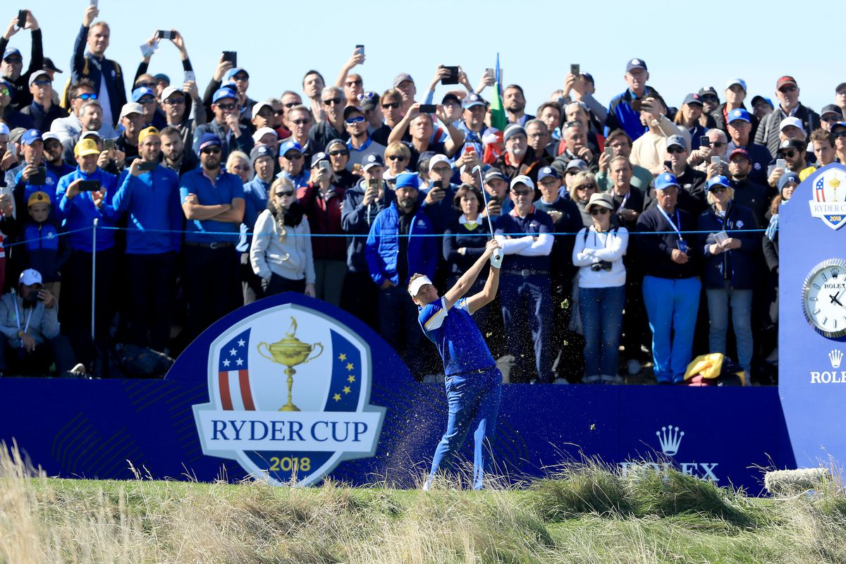 Ian Poulter of the European Team plays his tee shot on the second hole in his match against Dustin Johnson of the European Team during singles matches of the 2018 Ryder Cup at Le Golf National on September 30, 2018 in Paris, France.