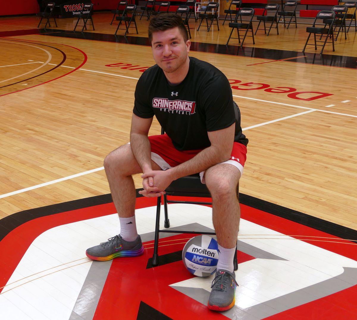 Shaughn McDonald rocks his Pride shoes at the St. Francis gym.