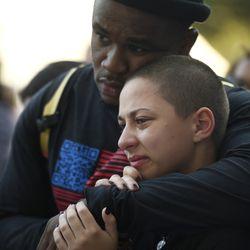 Parkland student activists Jammal Lemy, left, and Emma Gonzalez embrace | AP Photo/Annie Rice