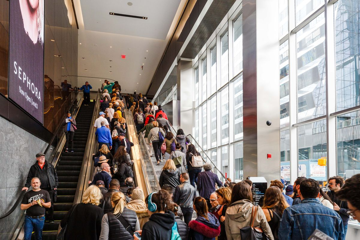 A pre-pandemic photo of the Hudson Yards mall shows patrons packed closely together on an escalator