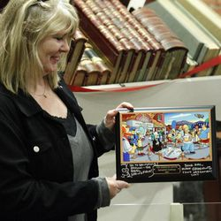 """Debra Gruell, Executive Director Springfield Museum, holds a plaque that was given by """"The Simpsons"""" creator Matt Groening at the Springfield Museum Tuesday, April 10, 2012, in Springfield, Ore. One of the best-kept secrets in television history has been revealed, with """"The Simpsons"""" creator Matt Groening pointing to Springfield, Ore., as the inspiration for the animated hometown of Homer and his dysfunctional family. Groening told Smithsonian magazine, published online Tuesday, that he was inspired by the television show """"Father Knows Best,"""" which took place in a place called Springfield. Springfield, Ore., is 100 miles south of Groening's hometown of Portland."""