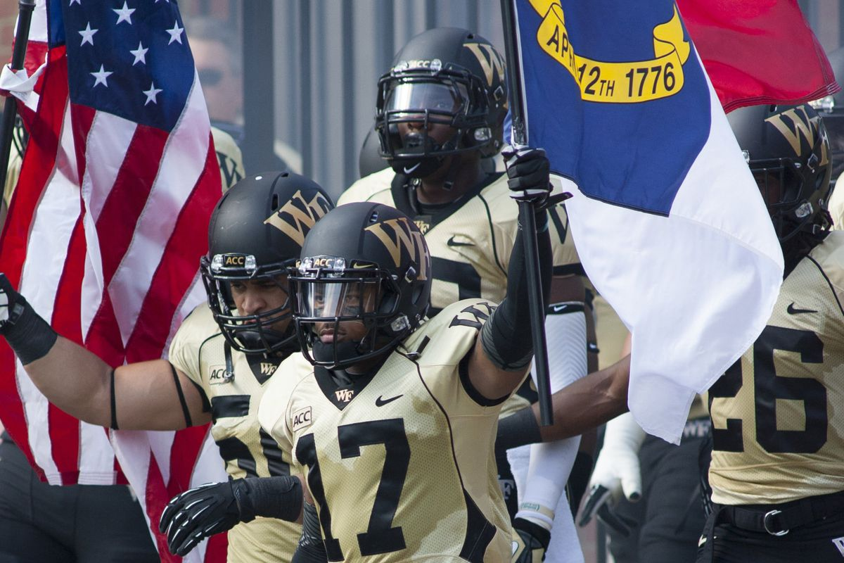 A.J. Marshall leads the Deacs on to the field