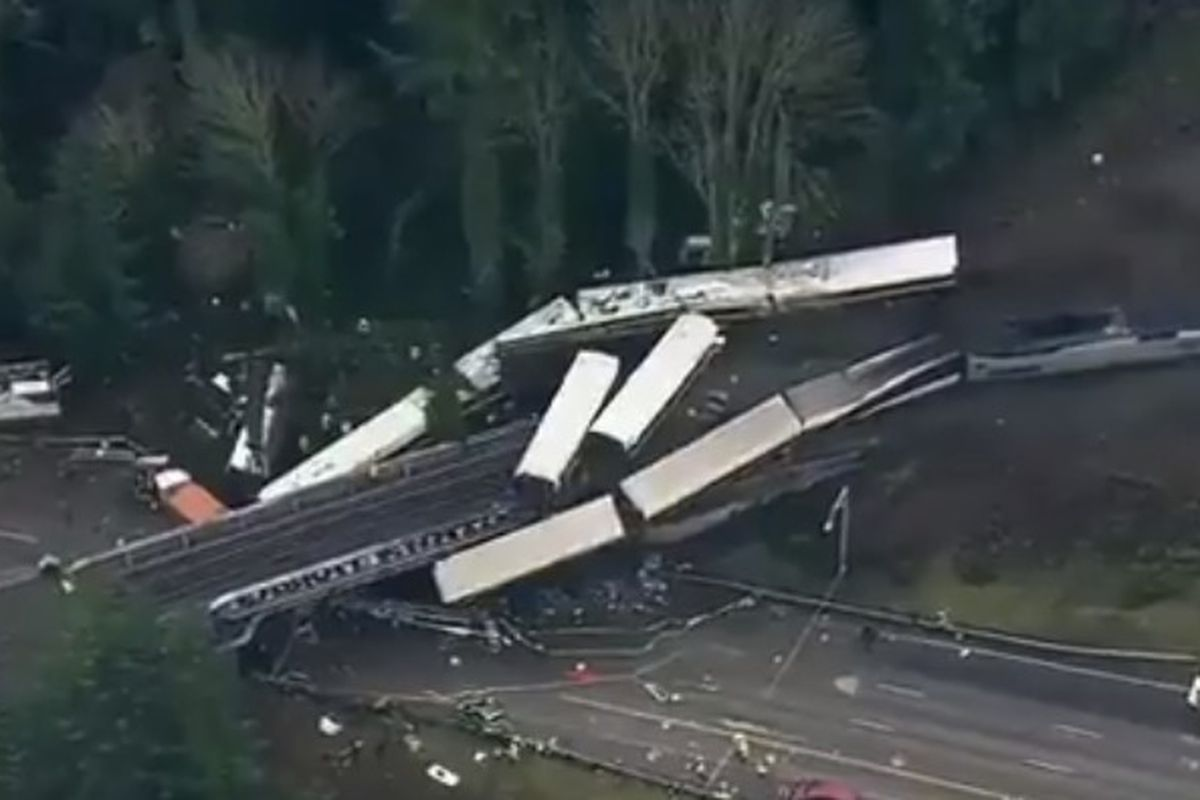 Newly released aerial footage shows an Amtrak train that crashed onto a highway bridge in Washington on Monday.