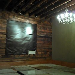 Dining area, featuring reclaimed wood from a 100-year old barn in Wisconsin; the wall is the future home for large pieces of artwork