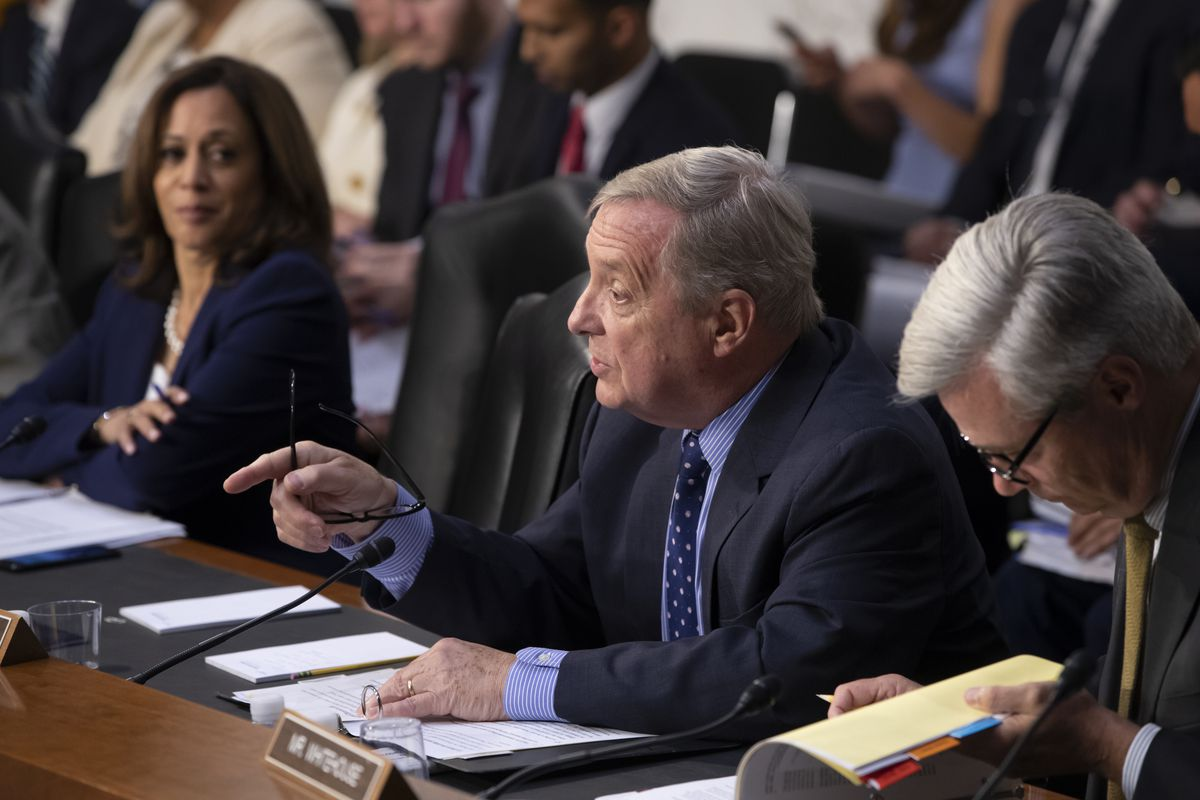 Sen. Dick Durbin, D-Ill., flanked by Sen. Kamala Harris, D-Calif. (left) and Sen. Sheldon Whitehouse, D-R.I., questions witnesses at a Senate Judiciary Committee hearing last year.