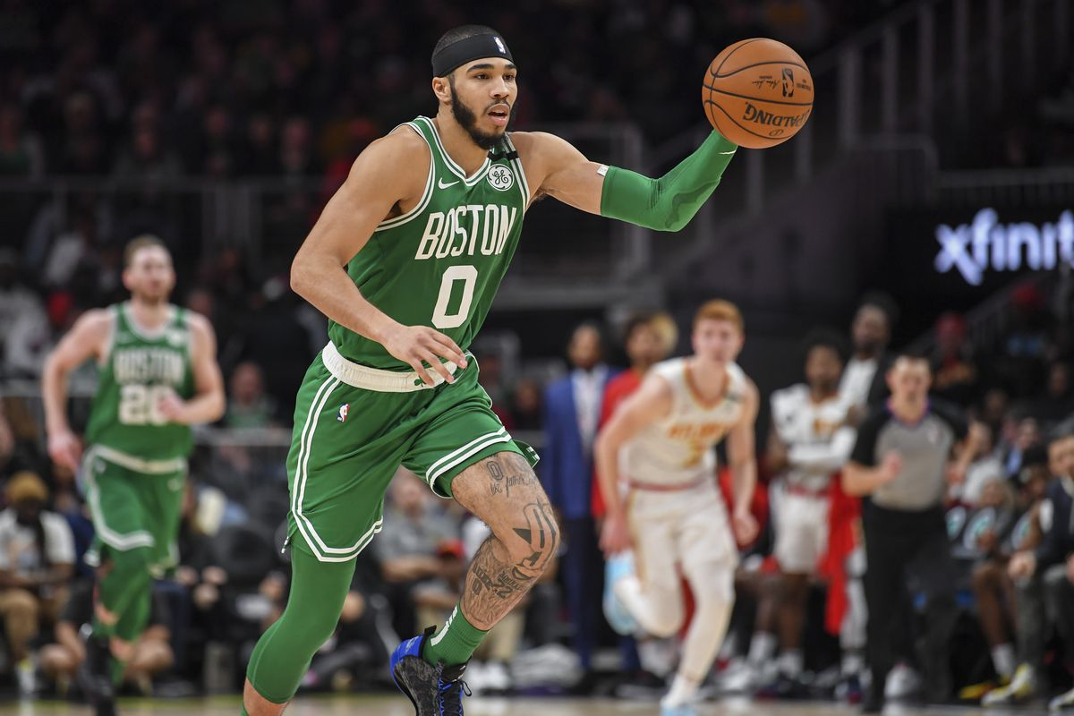 Boston Celtics forward Jayson Tatum breaks up the court after a steal against the Atlanta Hawks during the second half at State Farm Arena.