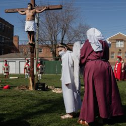 Ivana Paramo attends Via Crucis on the field of St. Procopius Catholic Church in Pilsen, Friday morning, April 2, 2021. The annual Via Crucis is a Good Friday tradition that reenacts the Stations of the Cross, a Catholic devotion that recounts Jesus' passion and death.