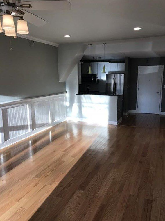 The same living room, but facing toward the open kitchen.