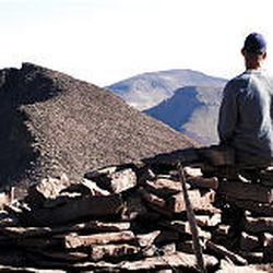 Craig Lloyd sits on South Kings Peak in 2003. He climbed Kings Peak, shown at left, and was going to head toward Gilbert Peak, center back, in an attempt to climb Utah's three tallest peaks in one day.