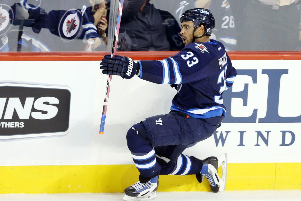 Dustin Byfuglien celebrates in Winnipeg