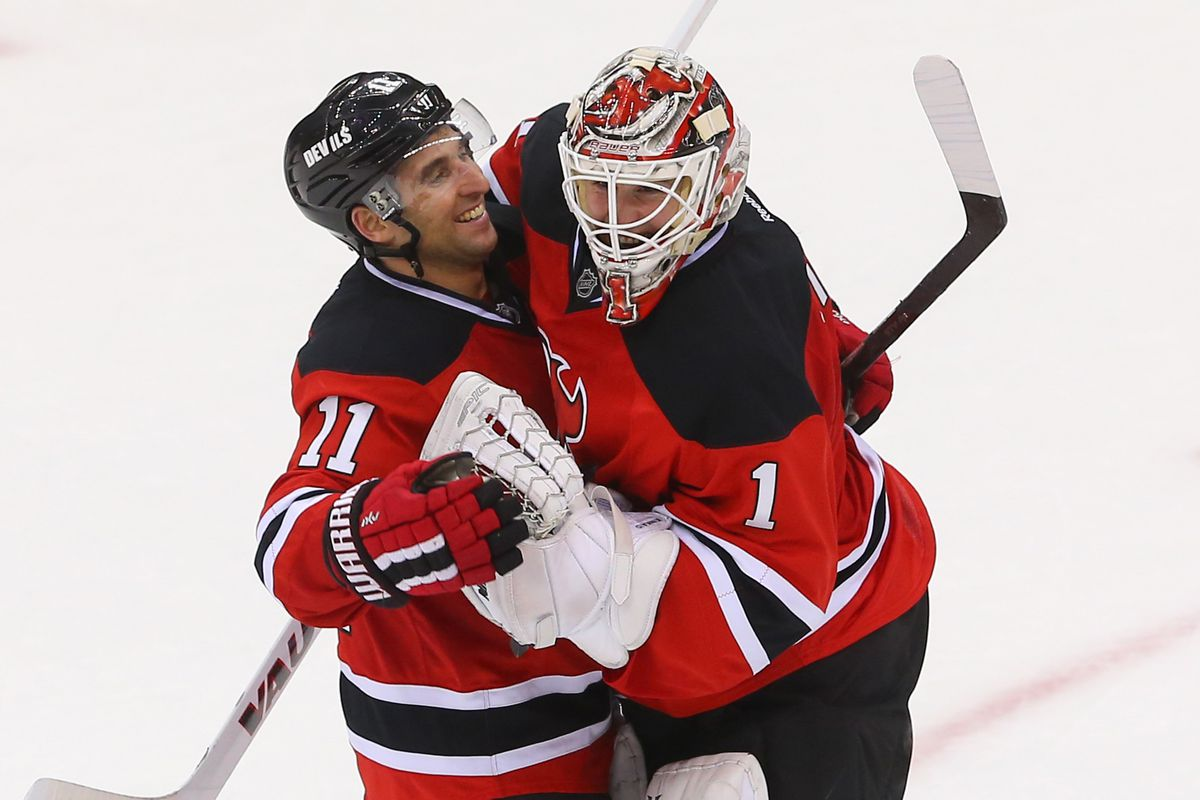 Keith Kinkaid got what every goalie works towards in December 2014: a hug from Stephen Gionta.  Also, his first win in the NHL.