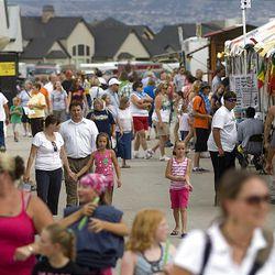 Visitors meander through the Salt Lake County Fair Wednesday in South Jordan.