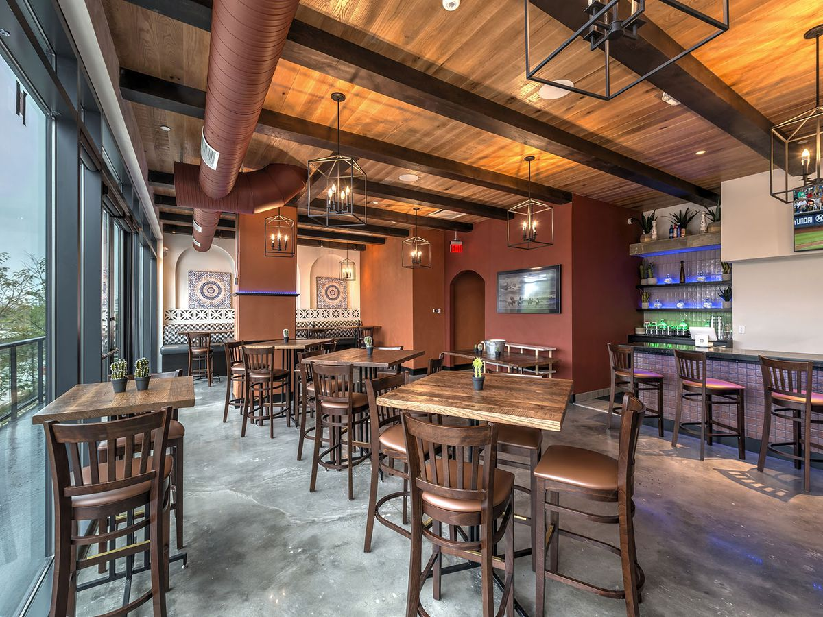 Wooden ceilings and furniture, a full window view and wooden flooring in Mission's Cactus Room