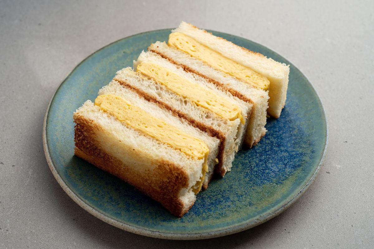 An egg omelette sandwich on toast from Konbi.