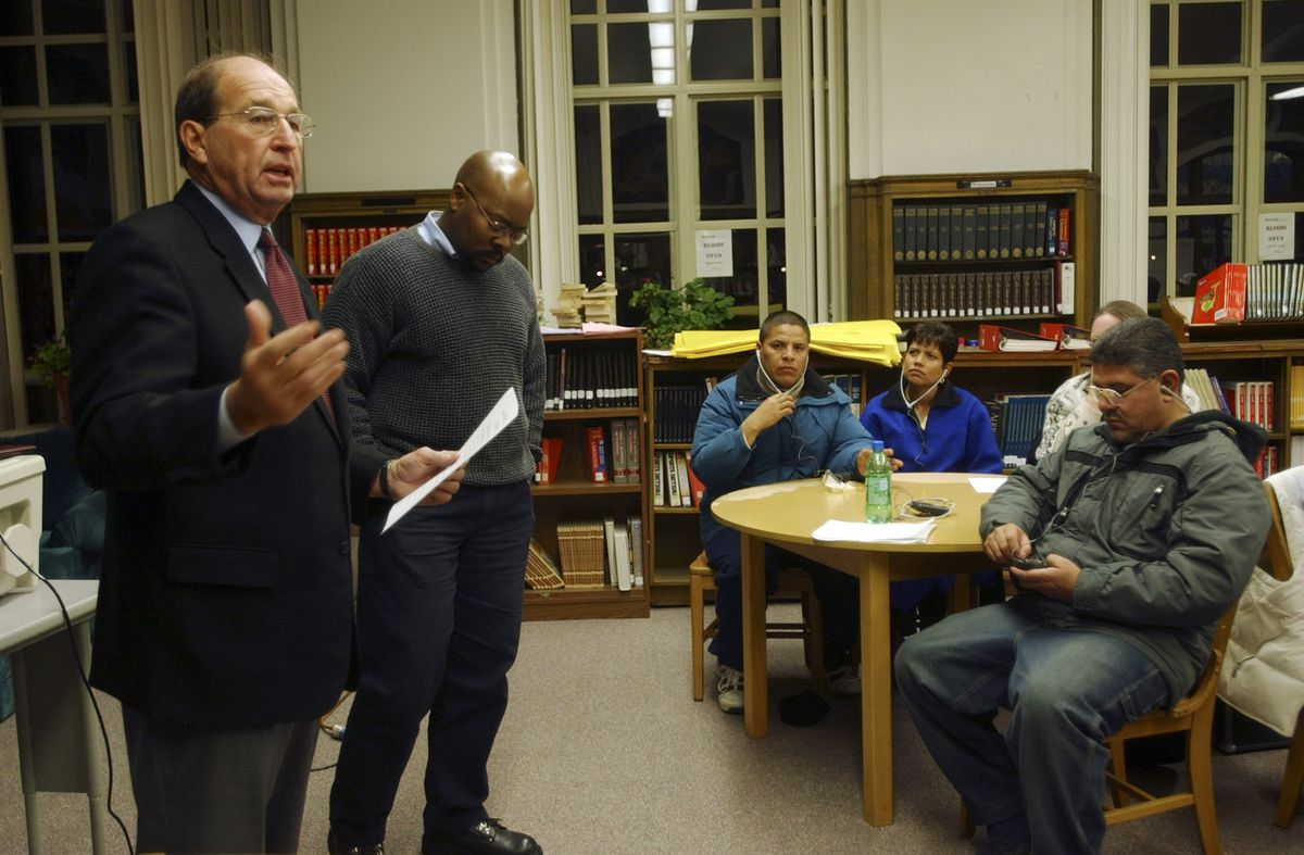 Former Denver Superintendent Jerry Wartgow and former State Board of Education member Rico Munn addressed Cole Middle School.