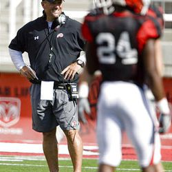 Head coach Kyle Whittingham shows his lighter side at the final Ute preseason scrimmage at Rice-Eccles Stadium in Salt Lake City Saturday.