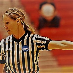 Laura Rahe referees a basketball game. Rahe is married to Weber State men's basketball coah Randy Rahe. Nowadays, she primarily officiates women's games in the Mountain West Conference.