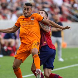 Houston Dynamo midfielder Darwin Cerén (24) heads the ball as RSL and Houston play an MLS soccer game at Rio Tinto Stadium in Sandy on Saturday, June 26, 2021.