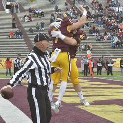 Tommy Lazzaro and Hunter Buczkowski embrace in mid-air after a touchdown run,
