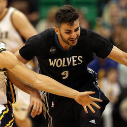 Minnesota Timberwolves guard Ricky Rubio (9) attempts to control a loose ball as Utah Jazz guard Raul Neto (25) reaches for it in the second half of an NBA regular season game at the Vivint Arena in Salt Lake City, Friday, April 1, 2016.