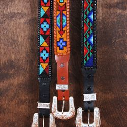 Hand-beaded, sterling silver belt, $2000. Available in black, cognac.