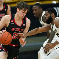 Utah forward Mikael Jantunen, left, drives the lane as Colorado forward Jeriah Horne defends in the first half of an NCAA college basketball game, Saturday, Jan. 30, 2021, in Boulder, Colo. (AP Photo/David Zalubowski)
