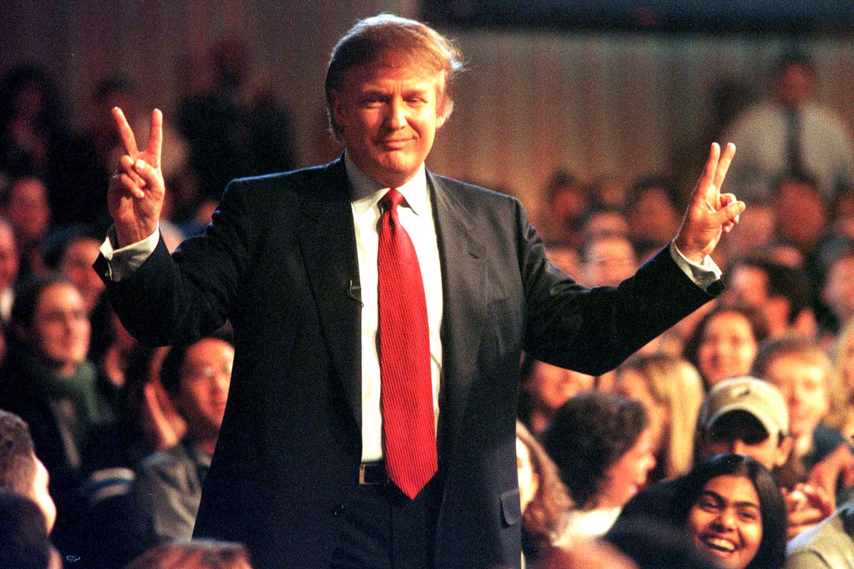Donald Trump enters a taping of Hardball with Chris Matthews on November 18, 1999, when he was weighing a bid for the Reform Party's presidential nomination.