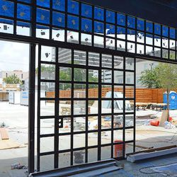 The glass wall rolls open all way creating an indoor/outdoor space in seconds.