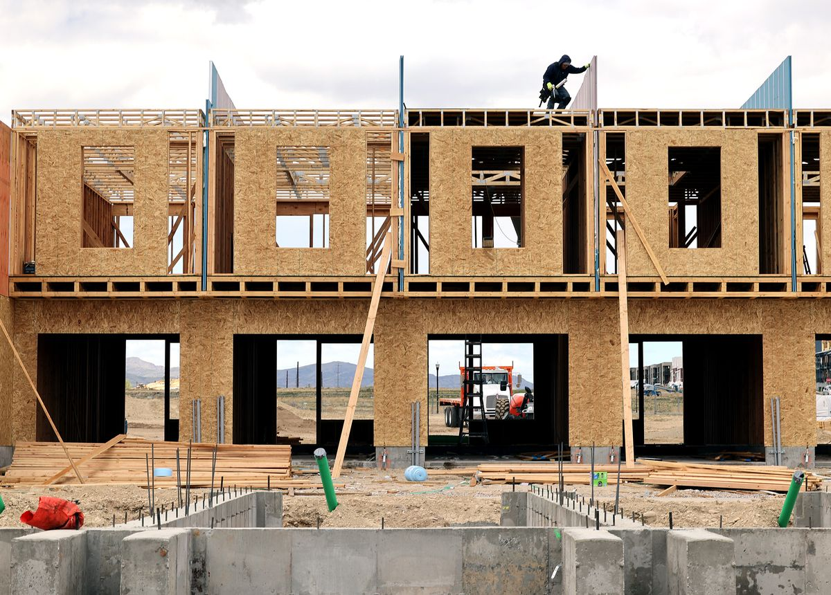 Home builders work at a building site in South Jordan on Monday, May 10, 2021. Unprecedented increases in the cost of lumber and other building supplies is driving up prices in Utah's already red-hot real estate and renovation markets.