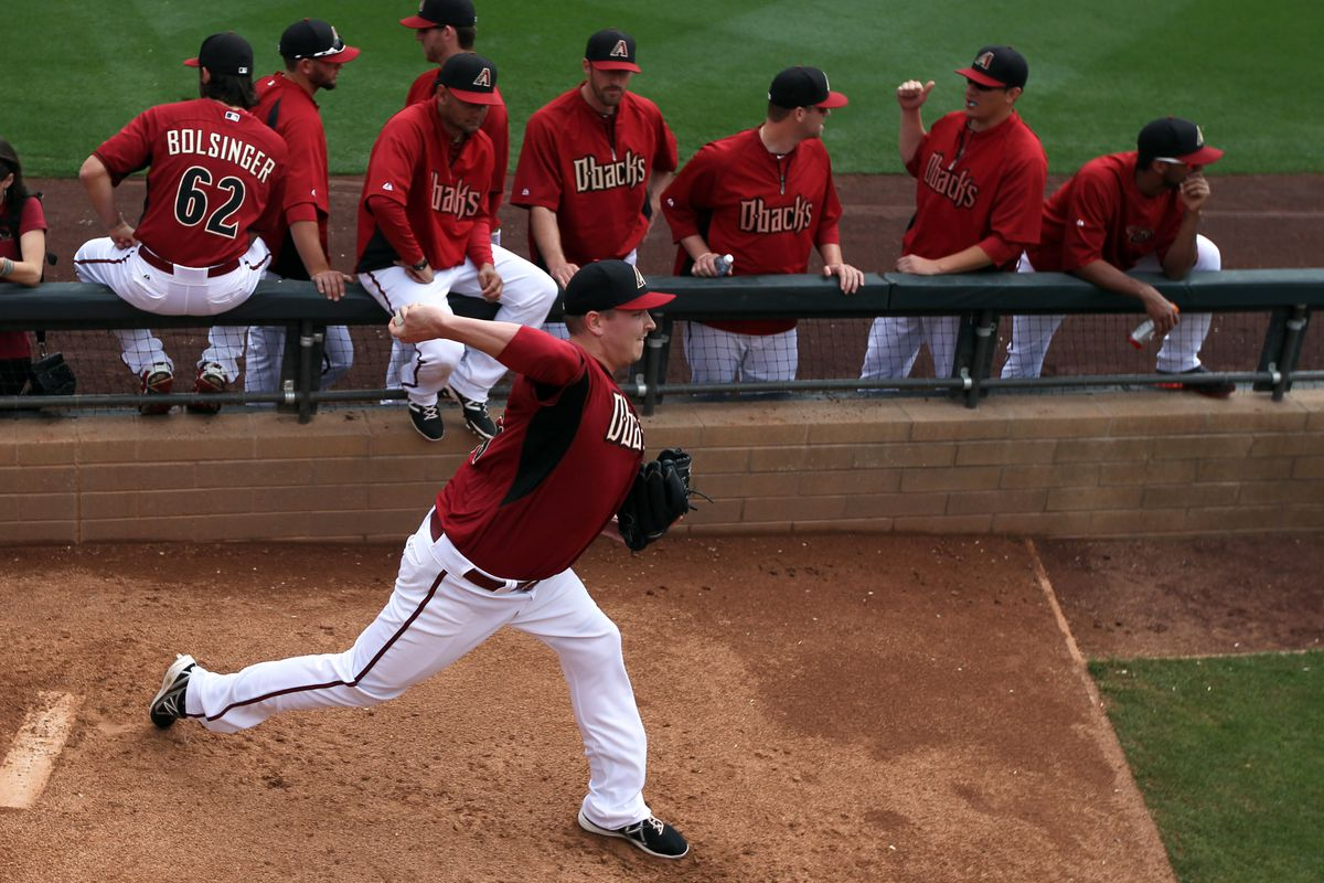 Part-time D-backs reliever Trevor Cahill warms up in the Salt River Field bullpen during Spring Training