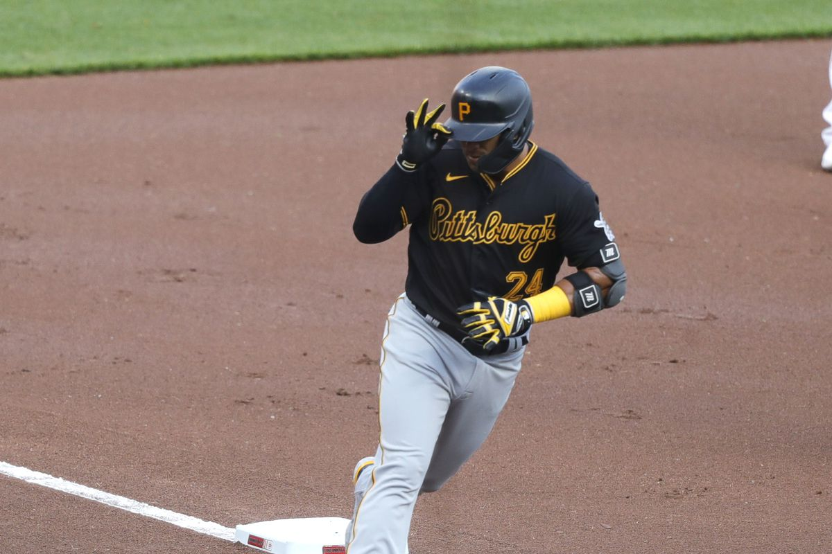 Pittsburgh Pirates third baseman Phillip Evans reacts as he rounds the bases after hitting a solo home run against the Cincinnati Reds during the first inning at Great American Ball Park.