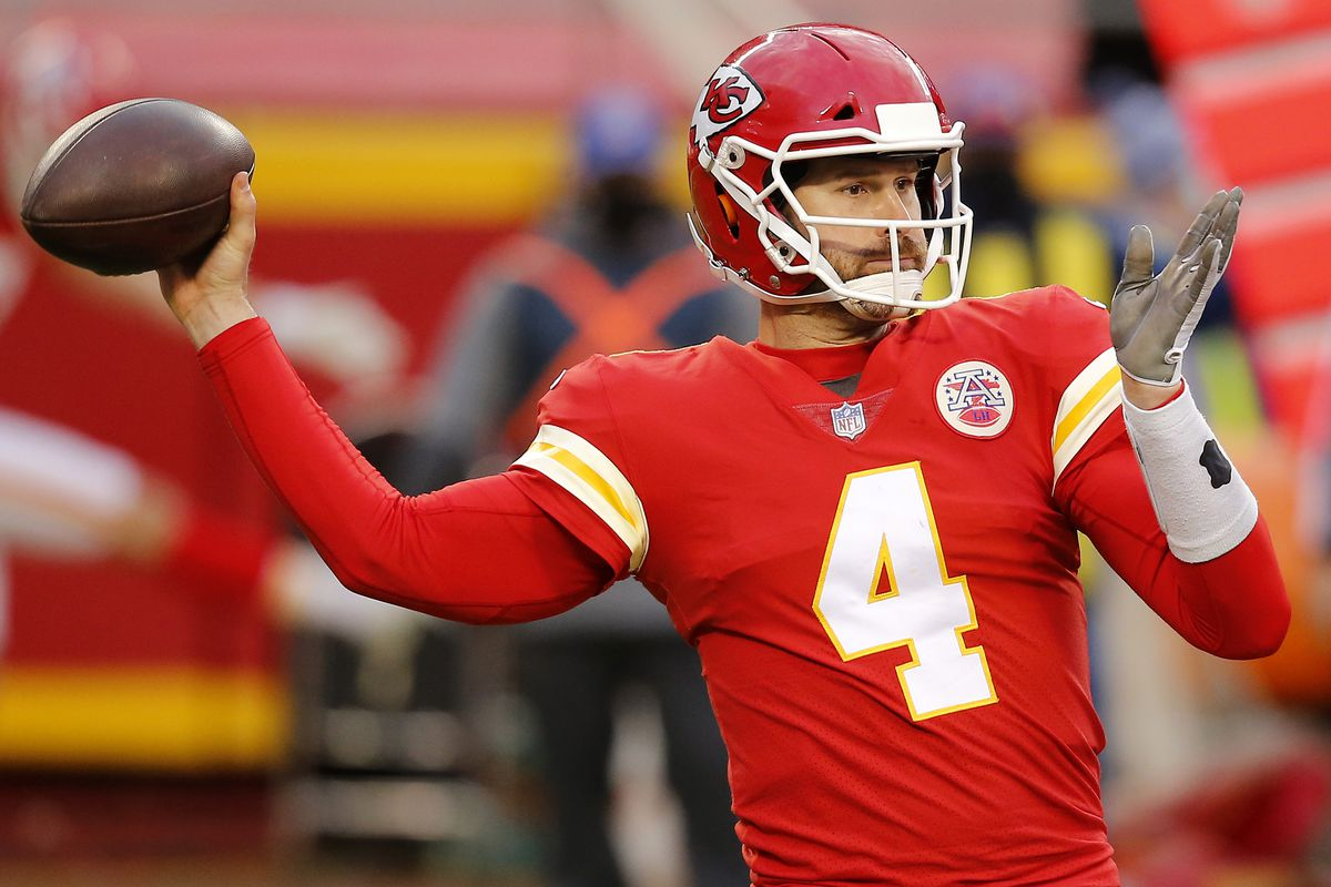 Quarterback Chad Henne of the Kansas City Chiefs delivers a pass over the defense of the Cleveland Browns during the fourth quarter at Arrowhead Stadium on January 17, 2021 in Kansas City, Missouri.