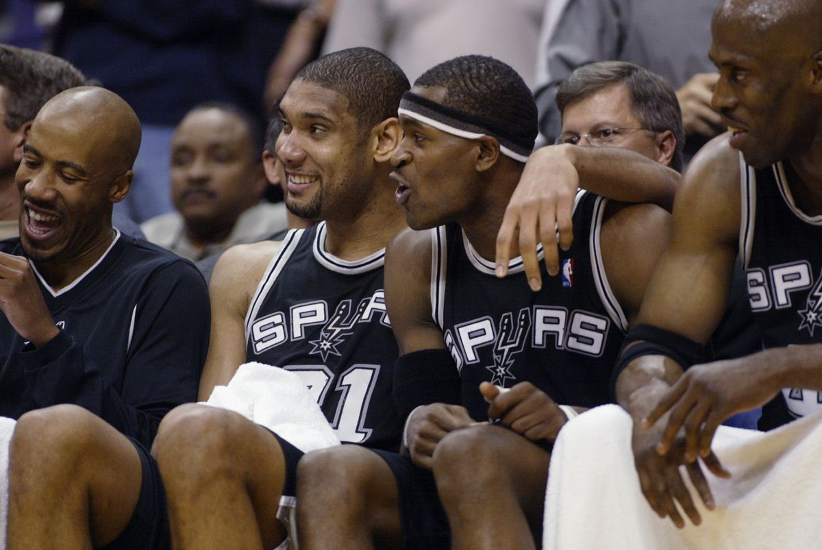 Tim Duncan and Jackson in 2003 (GettyImages)