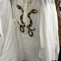 Figue top with snake embroidery, $50