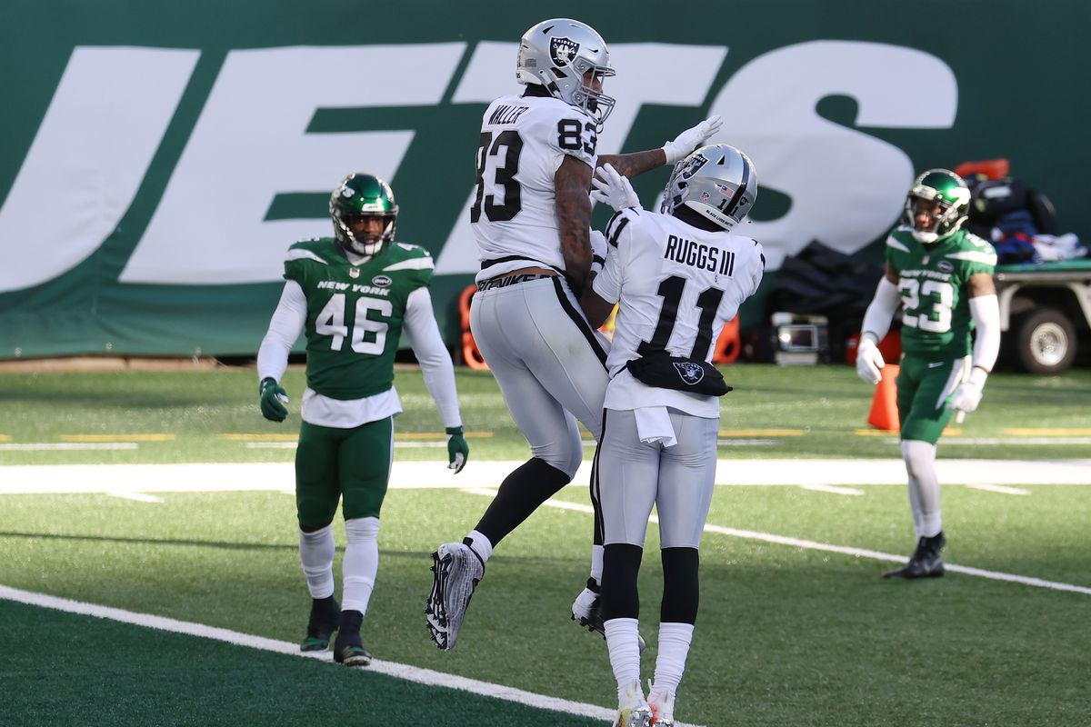 Darren Waller #83 of the Las Vegas Raiders celebrates his touchdown with teammate Henry Ruggs III #11 during the first half against the New York Jets at MetLife Stadium on December 06, 2020 in East Rutherford, New Jersey.