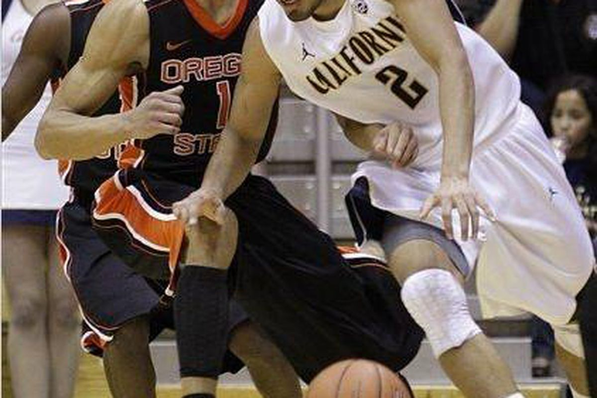 In what may also been a showdown for Pac-12 Player of the Year, California's Jorge Gutierrez (2) out-scored Oregon St.'s Jared Cunningham (1) 17-10, and the Golden Bears beat the Beavers. <em>(AP photo by Ben Margot)</em>